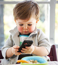 A Boy Plays Handphone