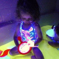 Toddler plays lamp