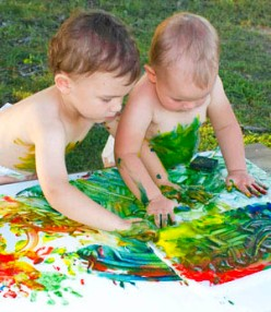 Children do finger painting on wide space